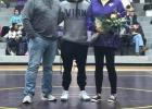 Vian High School senior wrestler Jake Coffee (center), shown here with his parents Dr. Logan and Jana Coffee, was recently honored on Senior Night inside Vian's Traw Fieldhouse. SUBMITTED