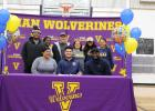 Vian senior Elijah Wright (bottom row, center) signed a national letter of intent to play college football at the University of Central Oklahoma in Edmond on Wednesday inside Traw Fieldhouse. Also pictured are (bottom row from left) parents Amber Wright a