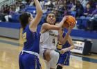 Vian's Kahleisha Wright dribbles up the floor ahead of Bethel's Kelsie Wood during Thursday's Class 3A, Area IV, area consolation first-round game in Checotah. A 33-32 loss to the Lady Wildcats ended the Lady Wolverines' season. LEA LESSLEY | NEWS